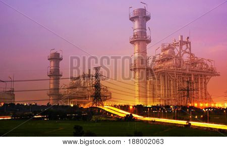 Double exposure of power plant and street lights at night.
