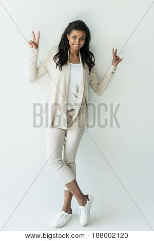 Attractive African American Woman Showing Peace Signs Isolated On White