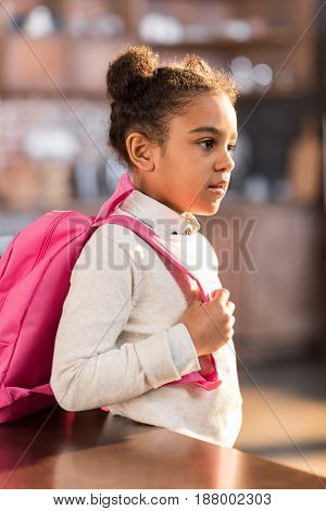 african american schoolgirl with backpack preparing for school elementary school student concept