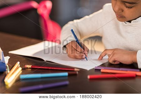 Cropped Shot Of Cute Little Girl Sitting At Table And Drawing With Felt Tip Pen, Doing Homework Conc