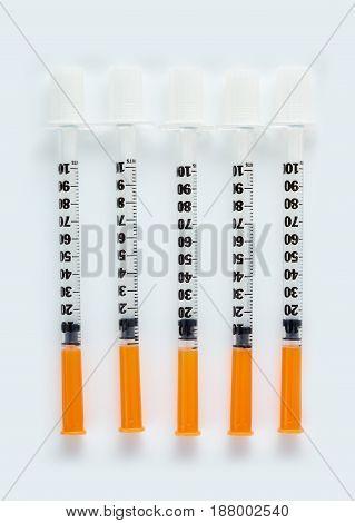 Three Insulin Syringes Isolated On White Background. Pile Of Medical Syringes. Single Insulin Syring