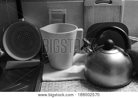 retro style crockery teapot, pit, pan, cups for cook at home stay on the table
