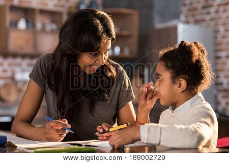 Smiling Mother And Daughter Learning Together And Doing Homework, Homework Help Concept