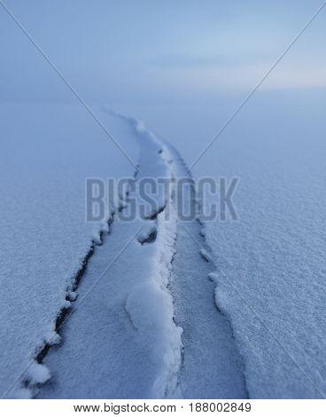 Winter Landscape. Lake Baikal. Crack In Ice.