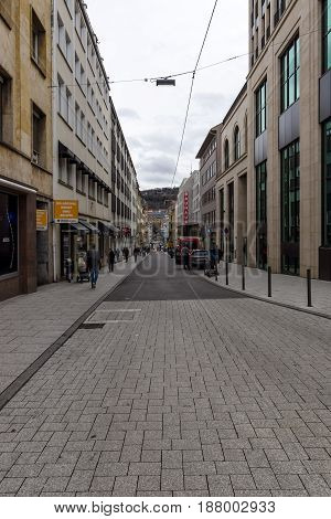 STUTTGART GERMANY - MARCH 01 2017: One of the shopping streets in the historical center. Stuttgart is the capital and the largest city of the state of Baden-Wuerttemberg.