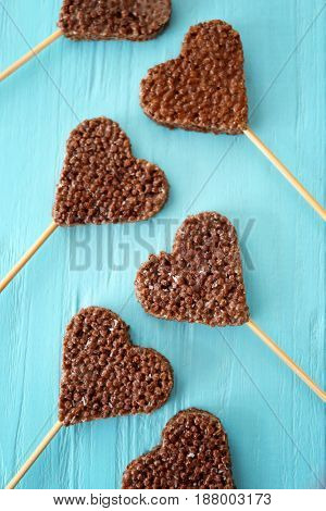 Heart shaped crispy dessert on wooden background, top view