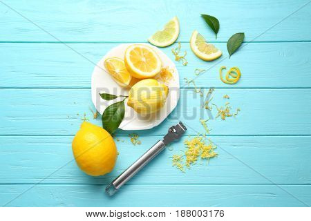 Composition with lemons and zest on wooden background