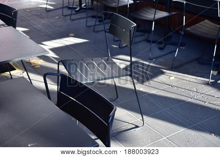 chair in morning sunlight at outside alfresco cafe