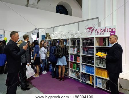 KIEV - UKRAINE - MAY 2017: People visit the art and book exhibition in Arsenal museum in Kiev. They review the books at the publishers' stands