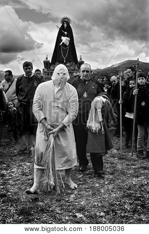 SAN VICENTE DE LA SONSIERRA SPAIN - GOOD FRIDAY FRIDAY APRIL 6: Man does penance through self-flagellation during Easter holy procession on April 6 2012 San Vicente de la Sonsierra Spain.