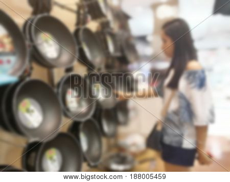 Blurred girl is shopping in department store in Thailand