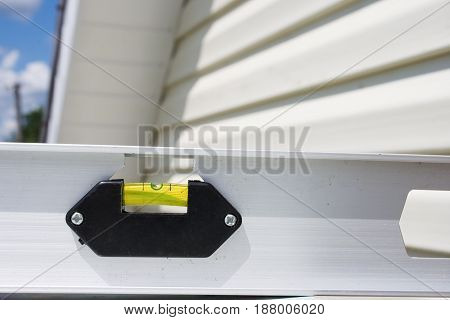 Level against the background of the siding