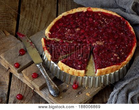 Tart, Cake With Red Cranberries And Walnuts On Wooden Background. Berry Pie. Space For Text