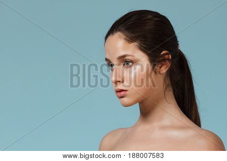 Fashion portrait of young beautiful nude girl with natural make up. Copy space.