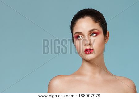 Fashion portrait of young beautiful nude girl with bright make up. Copy space.