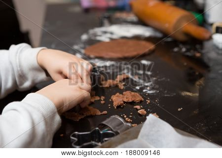 Young Child Learning To Bake For The First Time