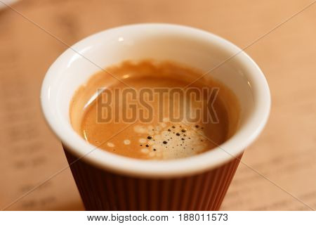 Paper Cup Of Coffee On Blurred Background