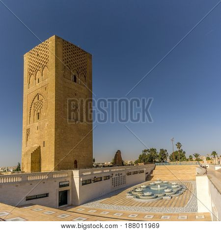 RABAT,MOROCCO - APRIL 7,2017 - View at the Hassan tower with fountain near mausoleum of Mohammed V. Rabat is the capital city of Morocco and its second largest city .