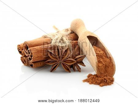 Cinnamon sticks and powder with anise stars isolated on white