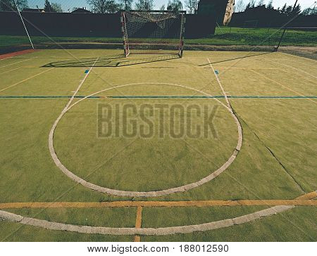 Empty Outdoor Handball Playground, Plastic Hairy Green Surface On Ground And White Blue Bounds Lines