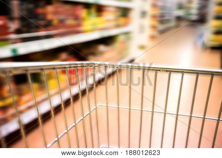 Supermarket retail shopping cart aisle speed blurred motion shelves
