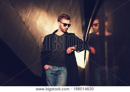 Young stylish confident handsome businessman model look his watch
