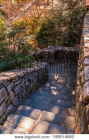 Stone stairs leading downward in the Stone Mountain Park in sunny autumn day Georgia USA