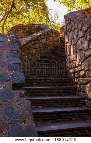 Stone stairs leading upward in the Stone Mountain Park in sunny autumn day Georgia USA