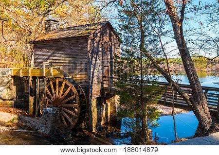 Grist Mill and Stone Mountain Lake in the Stone Mountain Park in sunny autumn day Georgia USA
