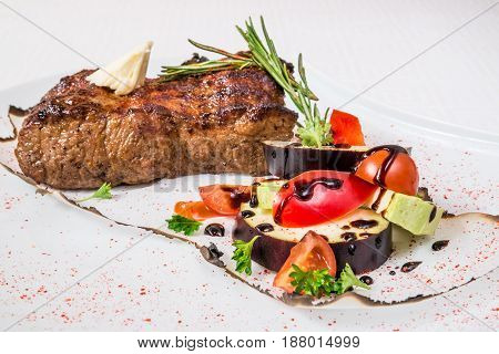 Delicious Barbecue. Appetizing Large Piece Of Roasted Meat, Vegetables, Sauce And Herbs, On A White