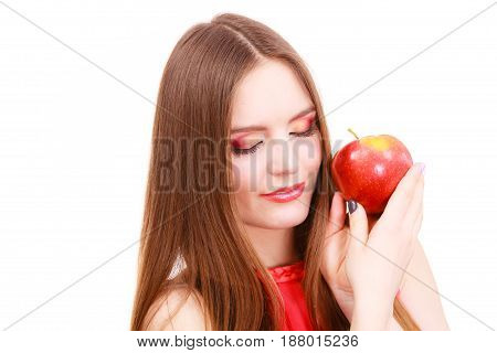 Woman young charming female long haired colorful make up holds big red apple fruit. Healthy eating vegetarian food dieting and people concept.
