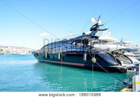 Super luxury yacht under a clear sky at marina Zeas, Piraeus, Greece