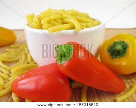Macaroni noodles in bowl and bell pepper