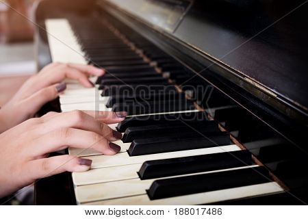 Closeup hand of women playing classic piano
