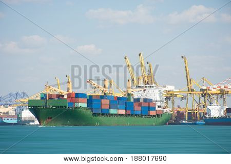 ship with container in dock on solf blue sky.