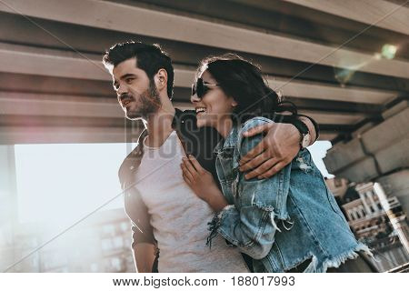 Happy couple. Beautiful young people bonding while spending time outdoors