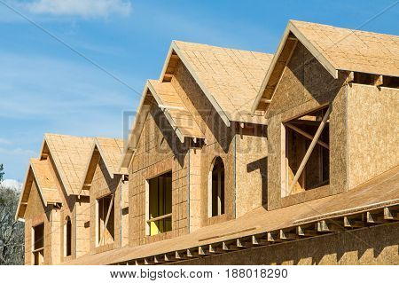 New townhouse construction of pine lumber and sheathing