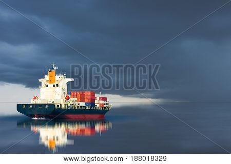 ship with container import export on storm sky.