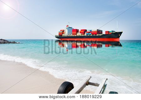 ship with container on blue sea import export goods.