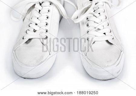 Pair of white sneakers with laces isolated on a white background