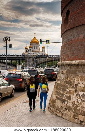 Embankment of Moscow. A view of the Cathedral of Christ the Savior. City traffic. Everyday life of Muscovites. View from the walls of the Moscow Kremlin.