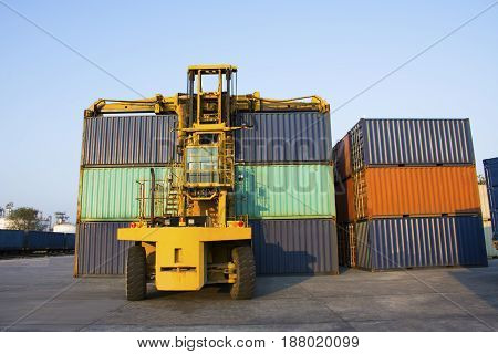container with forklift on blue sky loading to train.