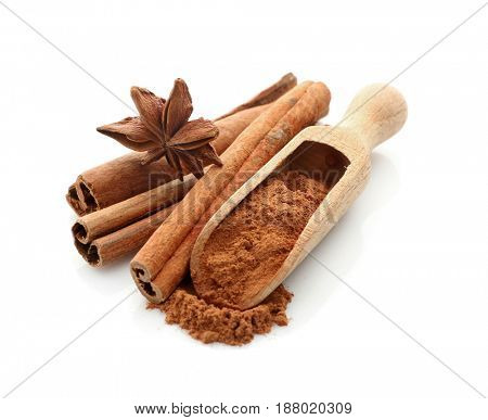 Cinnamon sticks and powder with anise star isolated on white
