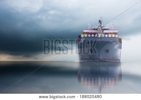 ship with container on stormy sky for import & export delivery goods to customer.