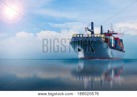 ship with container on blue sky import export goods.