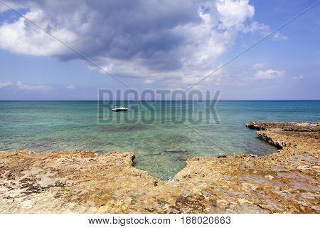 The rocky coastline on Seven Mile Beach on Grand Cayman island (Cayman Islands).