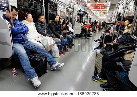 People Sitting In Subway Train In Tokyo, Japan