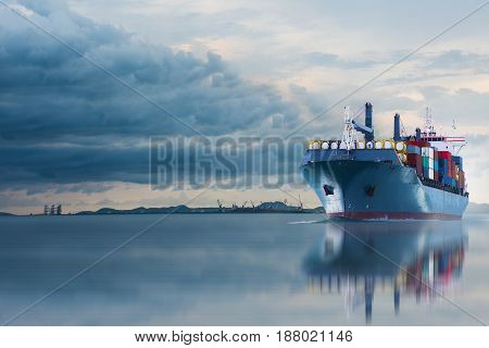 ship with container on storm sky import export.