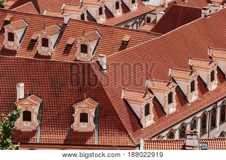 old red roofs with dormers from the air in Old town Prafue