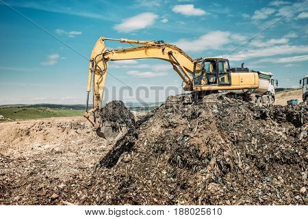 Industrial Works With Excavator Using Heavy Duty Scoop At Garbage Dumpsite